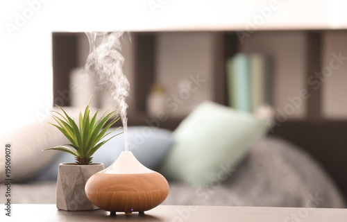 Aroma lamp on table