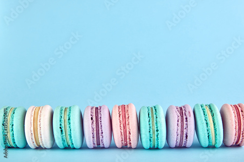 macaroons on a blue background Poster