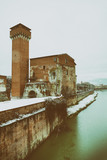 Citadel of Pisa with famous Lungarni after a snowfall. Medieval building of Tuscany, Italy