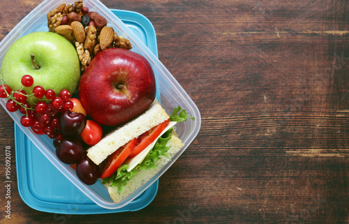 healthy food - lunch box with salad, sandwich and fruit