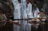 Beautiful Frozen Waterfall sculpture in mountain river Oker, National Park Harz  in Germany