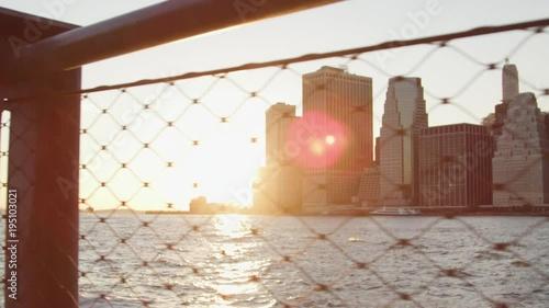 Manhattan Skyline At Sunset Viewed Through Wire Fence