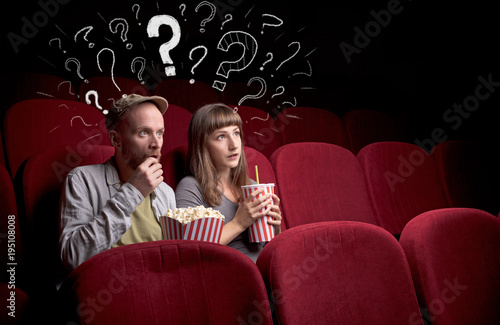 Couple in cinema with questions