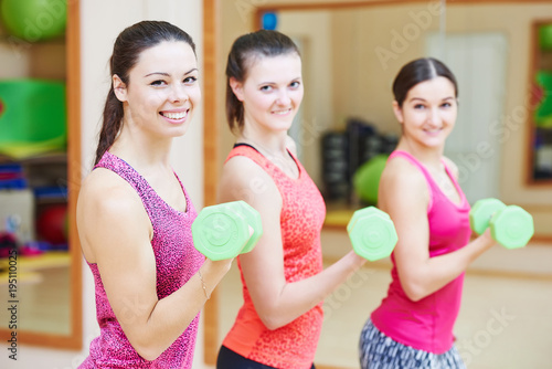 Aluminium Fitness young fitness woman with dumbbell in gym