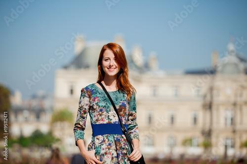 Fridge magnet girl in beautiful dress walking near Luxemburg garden