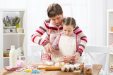 Mother and daughter cook at home. Making cookies, kitchen interior, healthy food concept - 195125848