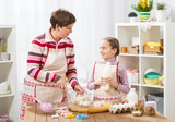 Mother and daughter cook at home. Making cookies, kitchen interior, healthy food concept - 195125867
