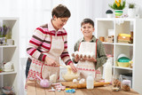 Mother and son cook at home. Healthy food concept - 195126039