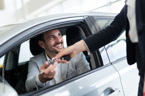 Portrait of happy customer buying new car - 195134475