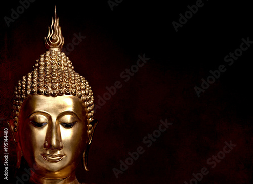 Aluminium Boeddha gold bhuddha statue close up smile face on vintage dark red background low key style