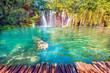 Leinwandbild Motiv Incredibly beautiful fabulous magical landscape with a waterfall in Plitvice, Croatia (harmony meditation, antistress - concept)