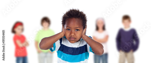 Sad child covering his ears isolated on a white background