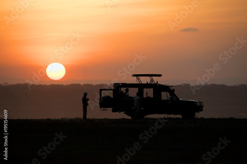Staande foto Oranje eclat Backlight sunset African landscape while in safari
