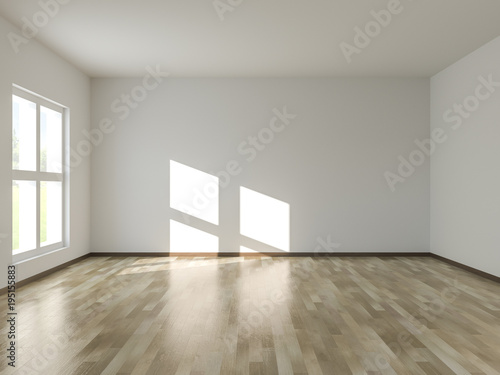 Empty room with sunlight shining through window