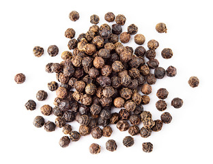 Black pepper. Heap of peppercorns isolated on white background. Macro. Top view. © Tim UR