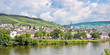 Panoramic landscape of the Mosel valley and river with a picturesque village, Germany
