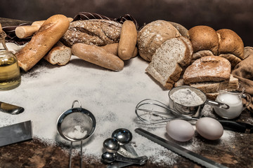 Different kinds of bread rolls on table wooden from above. Kitchen or bakery poster design © aedkafl
