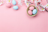 Fototapety Table top view shot of arrangement decoration Happy Easter holiday background concept.Flat lay colorful bunny eggs with spring floral on modern beautiful pink paper at office desk.Design pastel tone.