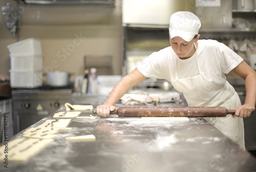 Papiers peints Kiev Pastry chef using a rolling pin on cake dough