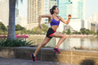 Woman in the city during her running workout - 195182283