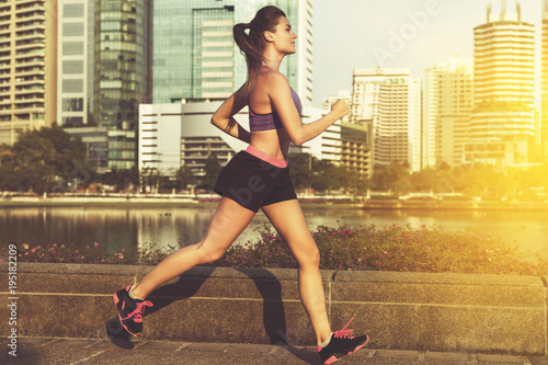 Poster Woman in the city during her running workout