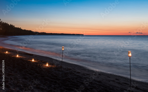 Candles and Lanterns on the Beach at Sunset