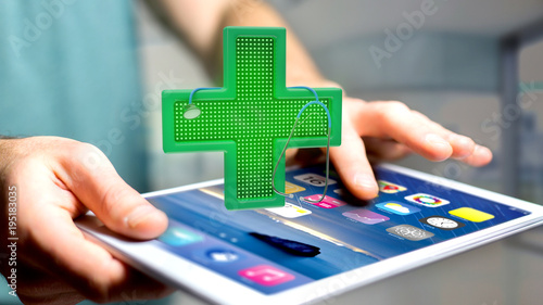 Fotobehang Apotheek Businessman using a smartphone with a Lighting pharmacy cross and a stethoscope - 3d render