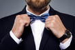 Man is fiting up a beautiful bow tie