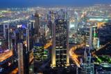 Aerial night view of skyscrapers of Dubai World Trade center