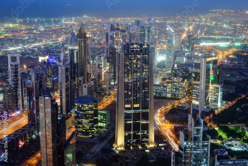 Tuinposter Dubai Aerial night view of skyscrapers of Dubai World Trade center