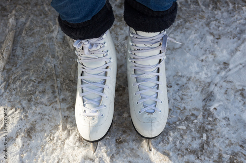 a woman stands in skates in the snow