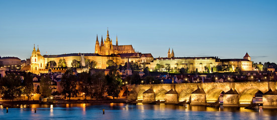 Panorama of Prague castle and Charles bridge by night, Czech republic