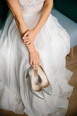 Shoes in the bride's hand