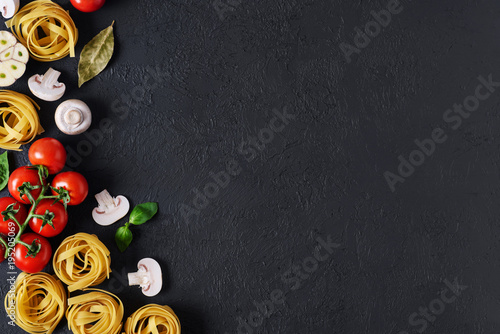 Ingredients for tagliatelle pasta on a dark background. - 195205069