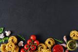 Ingredients for tagliatelle pasta on a dark background.