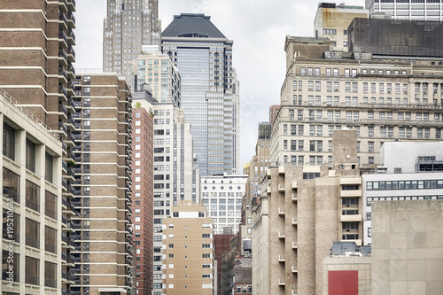 View of old and modern Manhattan buildings, New York City, USA. - 195210683