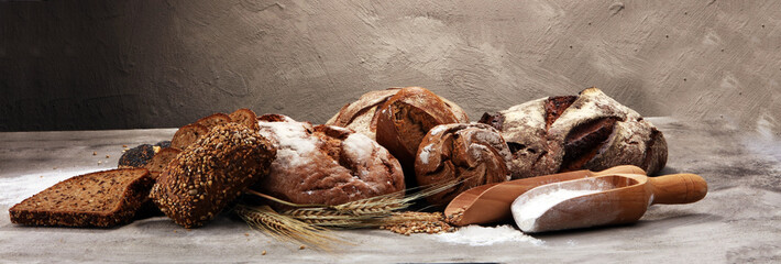 Different kinds of bread and bread rolls. Kitchen or bakery poster