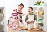 Mother and son cooking at home. Happy family. Healthy food concept - 195216235