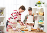Mother and son cooking at home. Happy family. Healthy food concept - 195216265