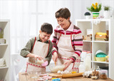 Mother and son cooking at home. Happy family. Healthy food concept - 195216289