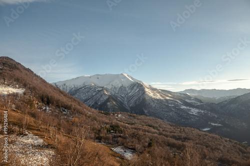 Tuinposter Diepbruine Snowy Caucasian mountains