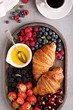Croissants with fresh berry and honey