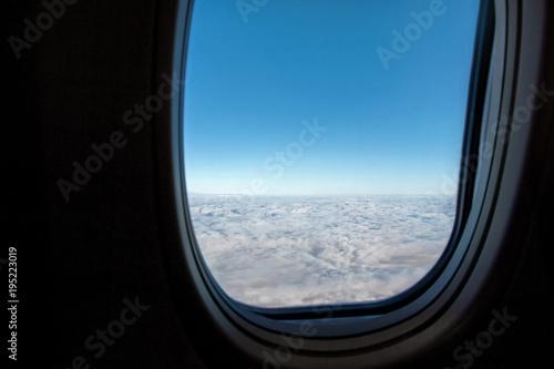blue sky outside airplane window - 195223019