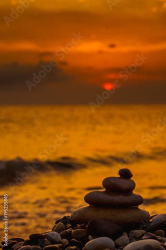 Foto op Canvas Zen stack of zen stones on pebble beach