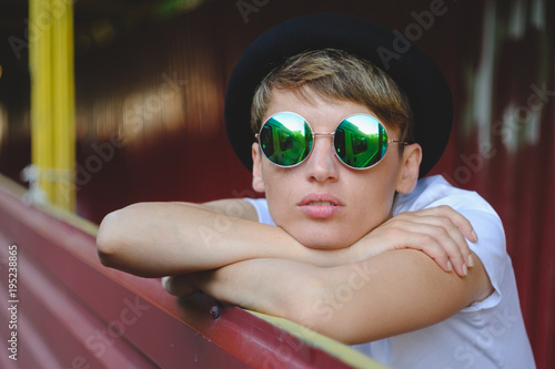 Young woman portrait wearing stylish hat and round glasses