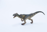 Allosaurus dinosaur roaring and in attack position with white background