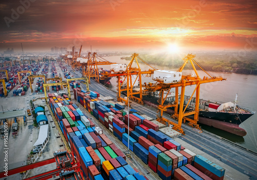 Poster Logistics and transportation of Container Cargo ship and Cargo plane with working crane bridge in shipyard at sunrise, logistic import export and transport industry background