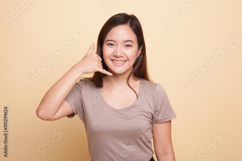 Young Asian woman show with phone gesture.