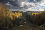 view from the hill to the autumn forest and a small river on a sunny day - 195295437