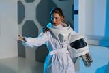 Woman astronaut on a futuristic spaceship. - 195297296